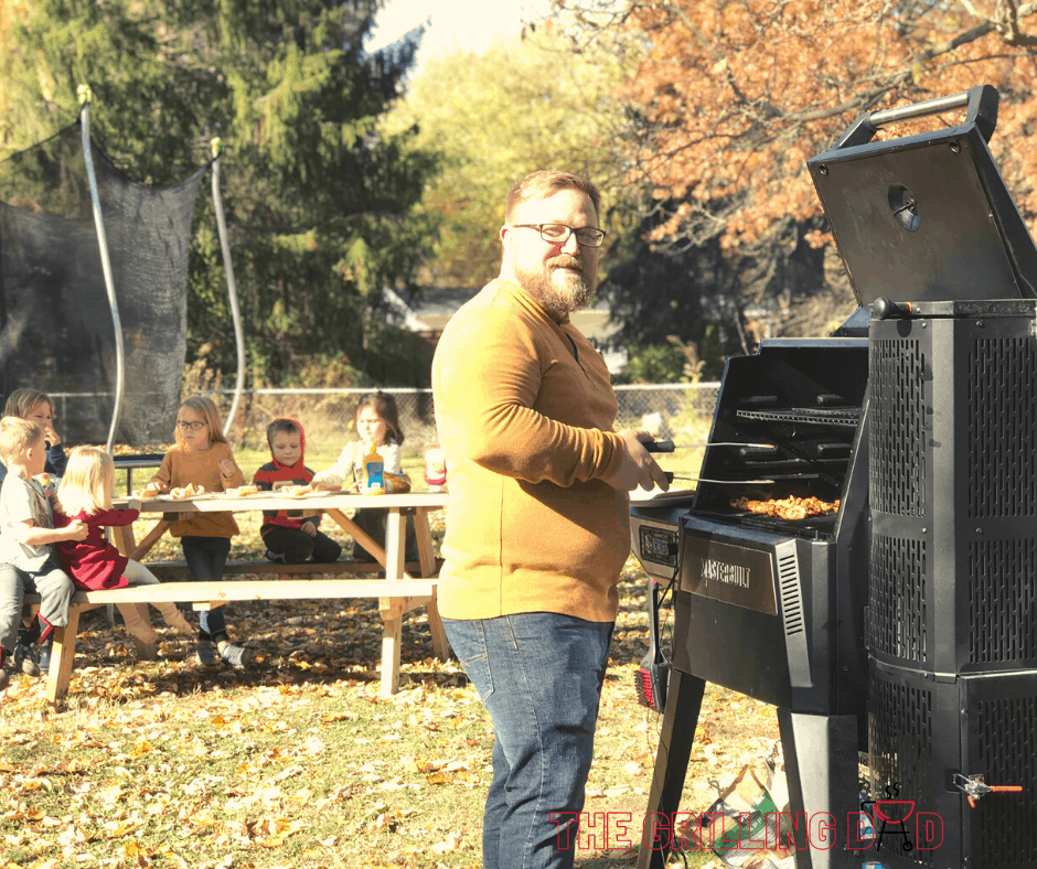 Dad grilling with kids